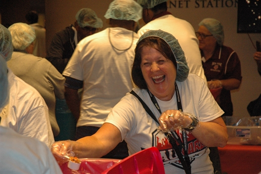 AAU Volunteers Pack 10,000 Meals for Underprivileged Youth in San Antonio During 125th AAU National Convention